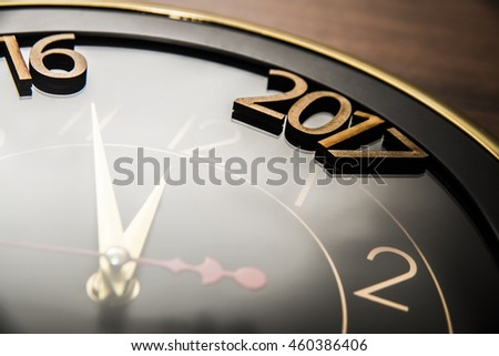 closeup of new year 2017 lie on clock face - dial. the end of 2016. Happy holiday time.