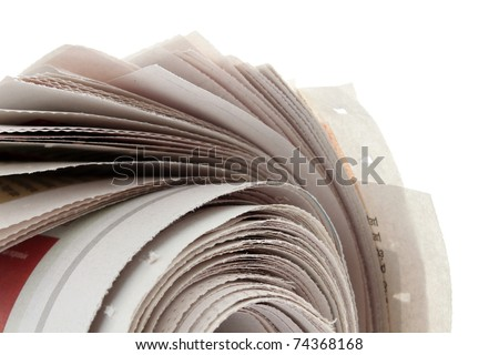 closeup of newspaper roll on white - stock photo