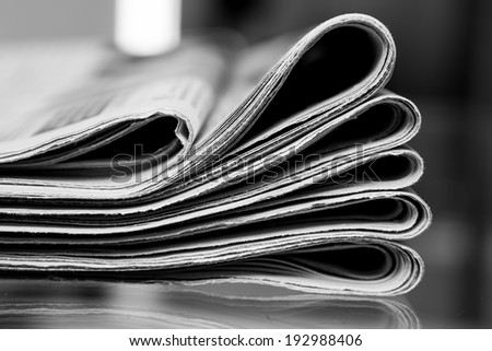 Closeup of newspapers, processed in black and white
