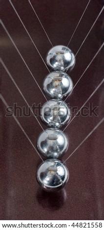 Closeup of Newton cradle - stock photo