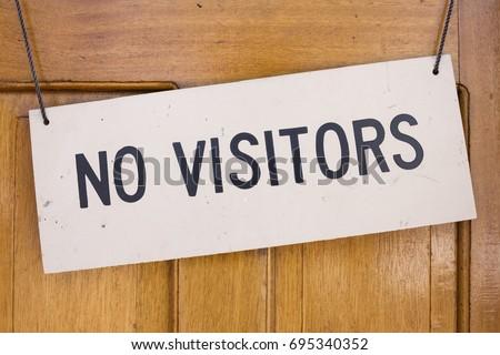 Closeup of No Visitors sign placard hanging on wooden door & Closeup No Visitors Sign Placard Hanging Stock Photo u0026 Image ...