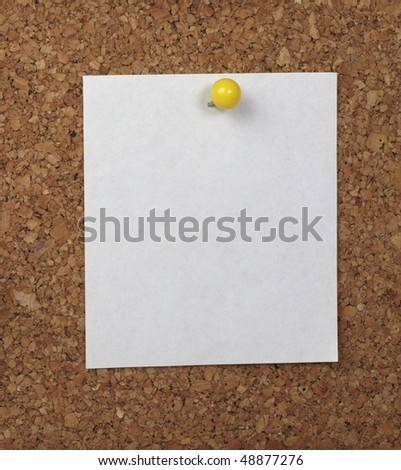 closeup of note paper  on cork board