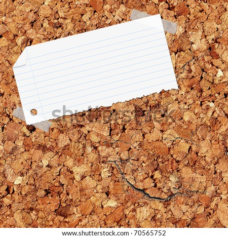 closeup of note paper on cork board - stock photo
