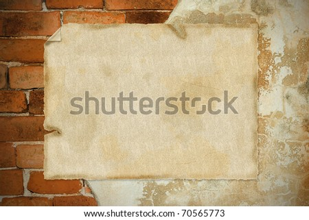 closeup of note paper on old weathered brick wall fragment - stock photo