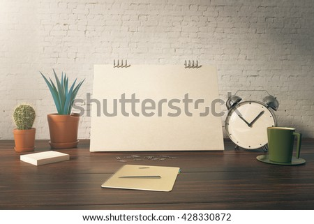 Closeup of office table with blank card, plants, coffee cup, alarm clock and stationery items on white brick background. Mock up, 3D Rendering - stock photo