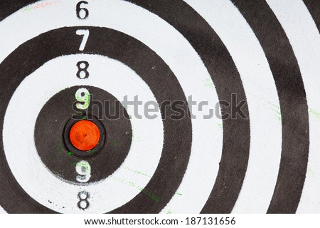 Closeup of old dirty black and white target as sport background. Skeet trap shooting.