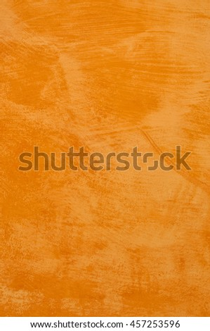 Closeup of old old orange plastered wall. - stock photo
