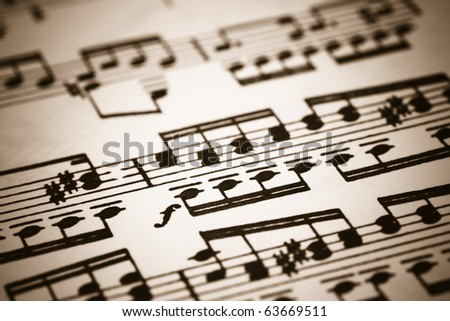 Closeup of old sheet music with selective focus in sepia - stock photo