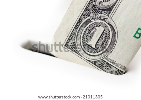 Closeup of one dollar bill going into piggy bank, focus on the bill, very shallow DOF; isolated on white background - stock photo
