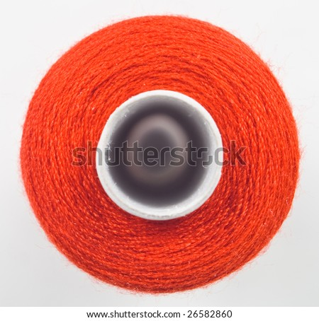 closeup of one red sewing spool