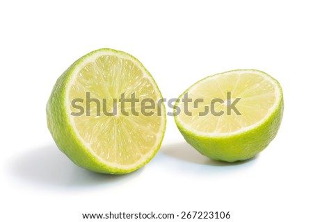 Closeup of one whole ripe lime fruit with water drops, isolated on white background - stock photo