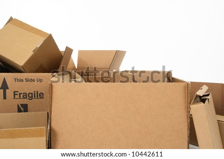 Closeup of open empty cardboard boxes. - stock photo