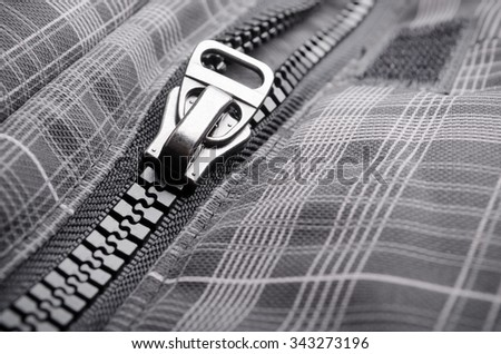 Closeup of opened clothing zipper - stock photo
