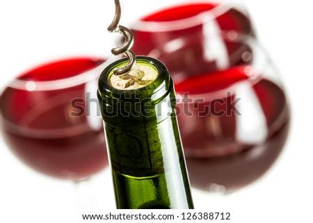 Closeup of opening green wine bottle - stock photo