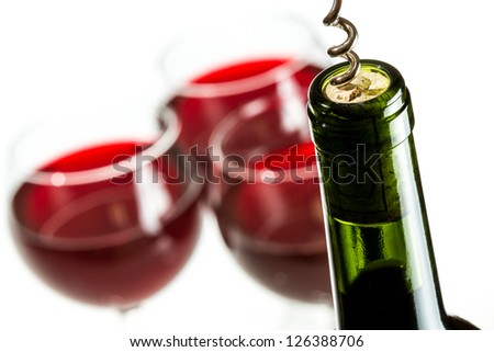 Closeup of opening wine bottle - stock photo