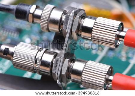 Closeup of optical communication connectors - stock photo
