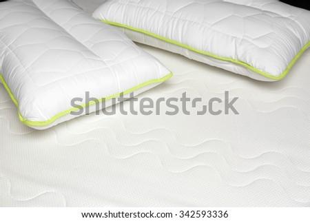 closeup of orthopedic mattress and pillows - stock photo