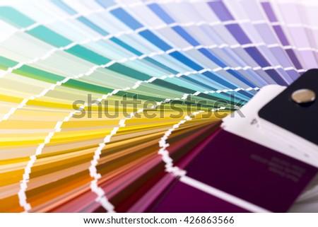 closeup of paint color sample catalog - stock photo
