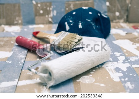 Closeup of painting tools and cap. - stock photo