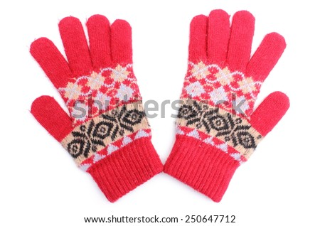Closeup of pair of colorful woolen gloves for woman. Isolated on white background - stock photo
