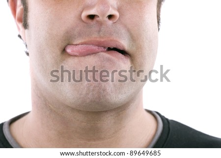 closeup of part of a face sticking out his tongue chicho - stock photo