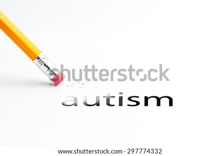 Closeup of pencil eraser and black autism text. Autism. Pencil with eraser. - stock photo