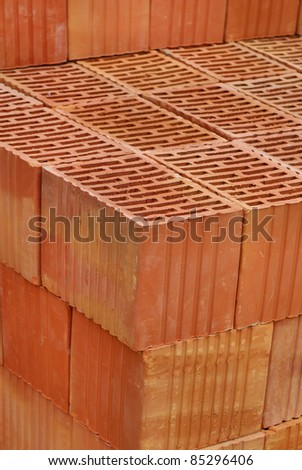 Closeup of perforated clay blocks. Unused Brick waiting for construction. - stock photo