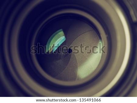 Closeup of photo camera lens background - stock photo