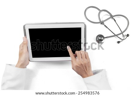 Closeup of physician hands using a digital tablet to work in the hospital - stock photo