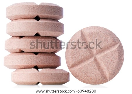 closeup of pink pills on white
