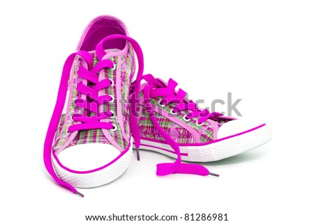 Closeup of pink sneakers with shoelaces isolated on white background - stock photo
