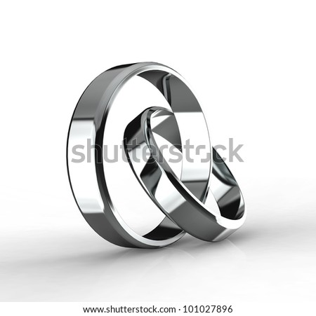 Closeup of Platinum wedding bands on a black background. - stock photo
