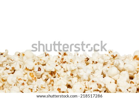 Closeup of popcorn border, isolated on the white background. - stock photo