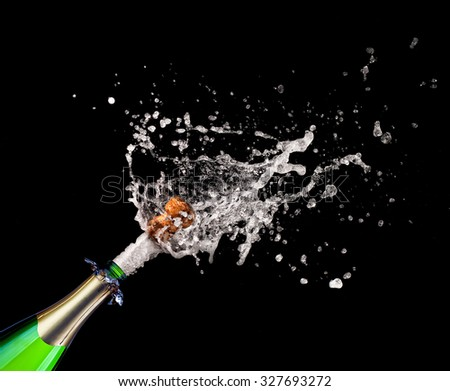 closeup of popping champagne and splash - stock photo