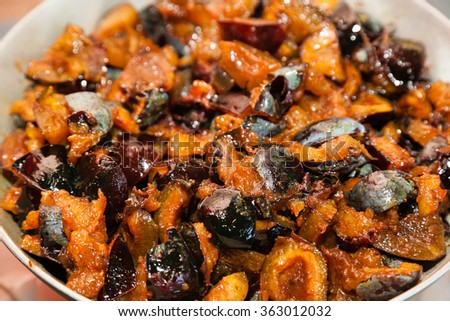 Closeup of preparing chutney sauce from plums - stock photo