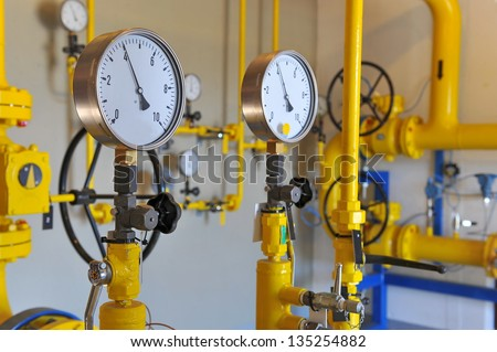 Closeup of pressure meter on natural gas pipeline - stock photo