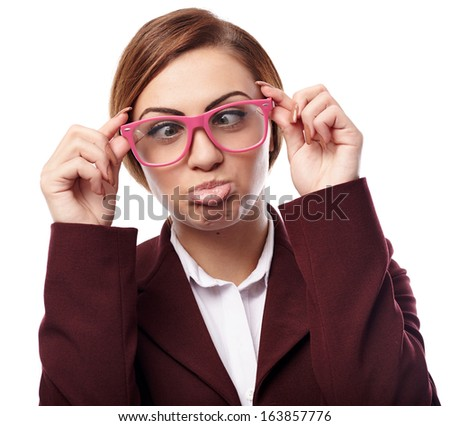 Closeup of pretty young woman wearing nerd glasses and making funny faces isolated on white background