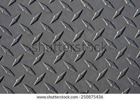 Closeup of real diamond plate metal material. - stock photo