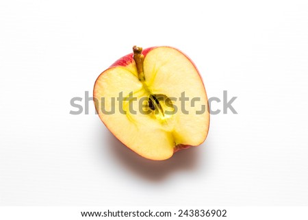 Closeup of red apple half isolated on white with clipping path - stock photo