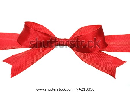 Closeup of red bow on white background.