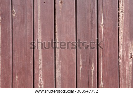 Closeup of red colored timbered fence. Wooden background - stock photo
