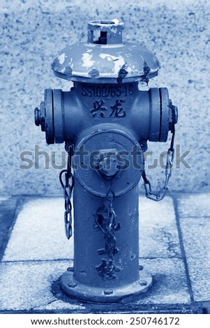 closeup of red fire hydrant in the street, north china - stock photo
