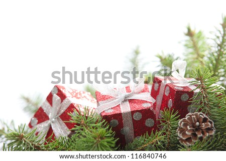 Closeup of Red gift boxes on pine branch,copy space for your text. - stock photo