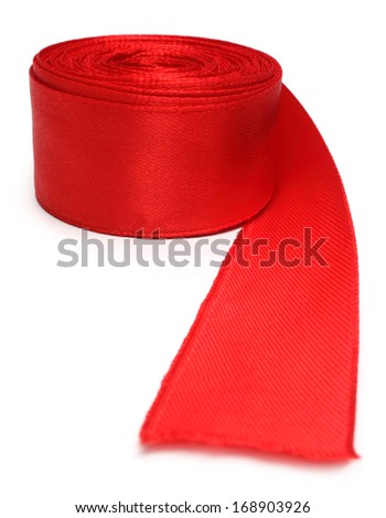 Closeup of red ribbon roll over white background