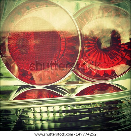 Closeup of red tail lights on car - stock photo