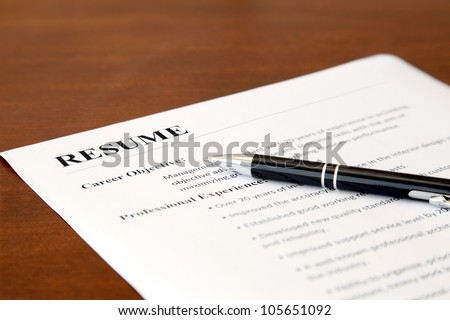 Closeup of Resume with Pen on the Table - stock photo