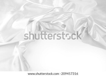 Closeup of rippled silk fabric. Copy space