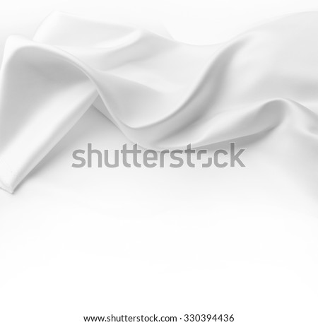 Closeup of rippled white silk fabric. Advertising copy space - stock photo