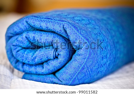closeup of rolled blue baby sling