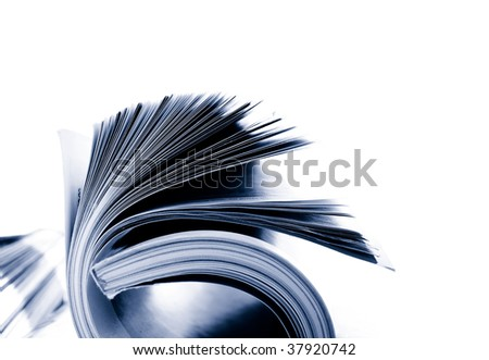 Closeup of rolled magazine pages, on white